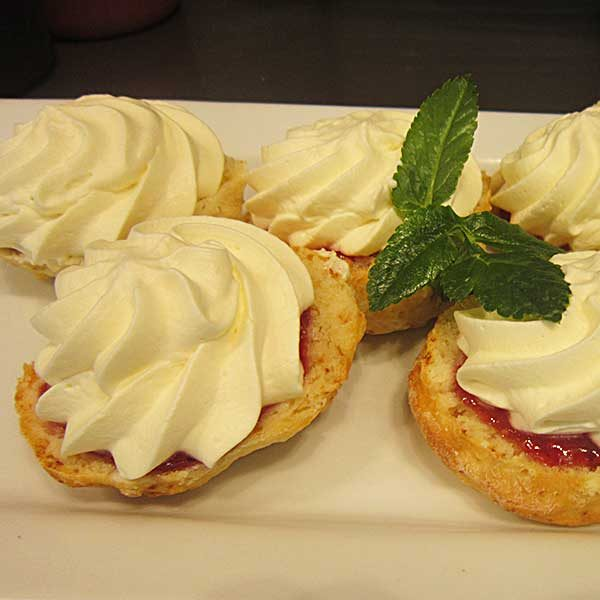 Sweet Scone Half Topped With Jam And Whipped Cream Third Place Cafe
